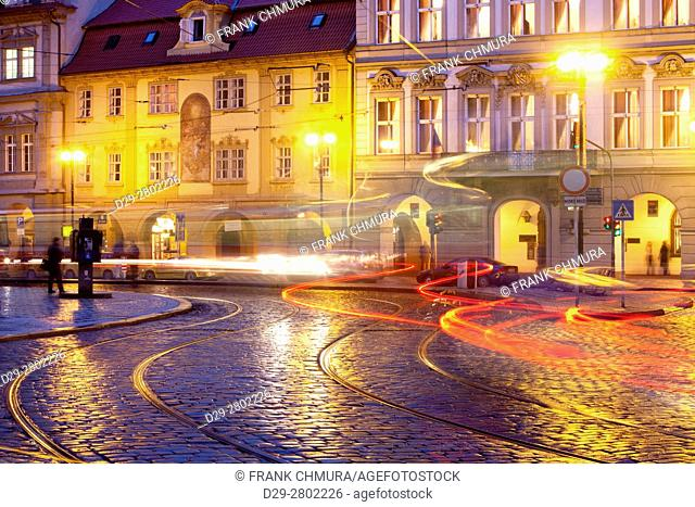 Prague - cars and tramways at Malostranske Square at dusk