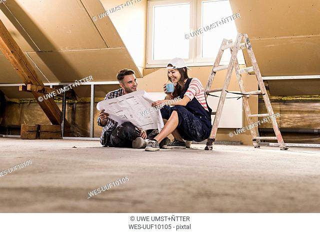 Young couple on construction site of theit new home
