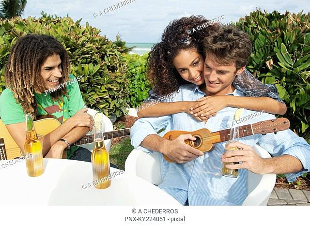Couple with their friend at a tourist resort