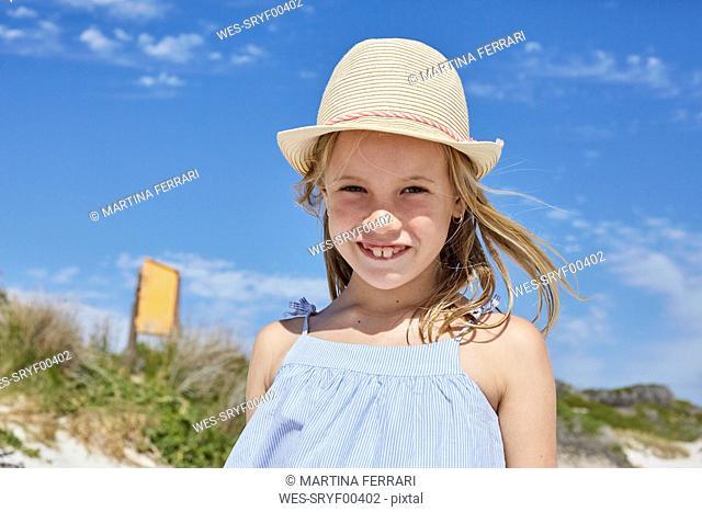Little girl wearing a straw hat