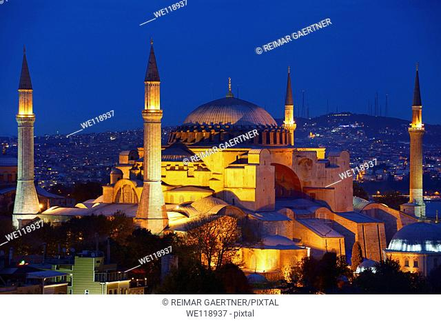 Night lights on Hagia Sophia and Sultan Selim Murat Turbesi at twilight in Istanbul Turkey