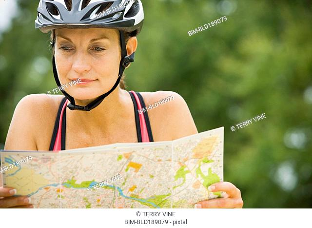 Mixed race woman riding bicycle