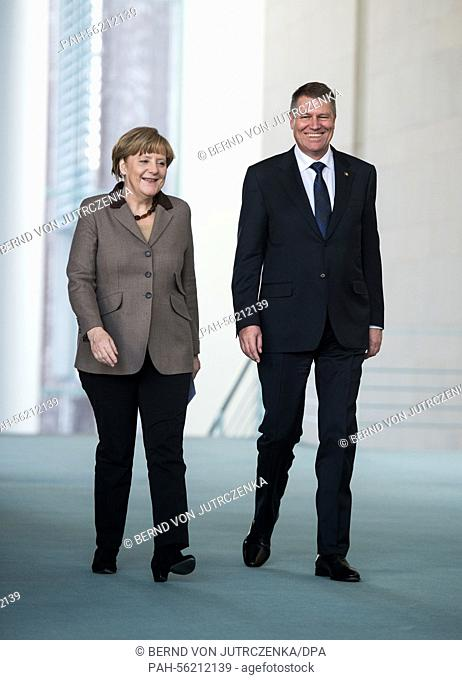 Romanian President Klaus Werner Iohannis and Chancellor Angela Merkel (l, CDU) arrive for a press conference in Berlin, Germany, 26 February 2015