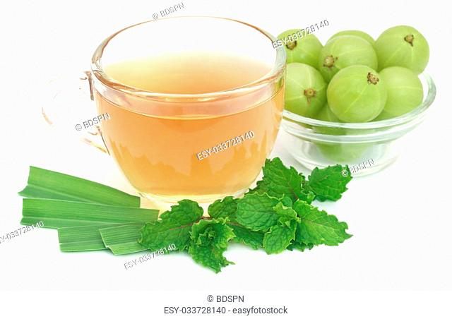Herbal tea with amla and lemon grass over white background