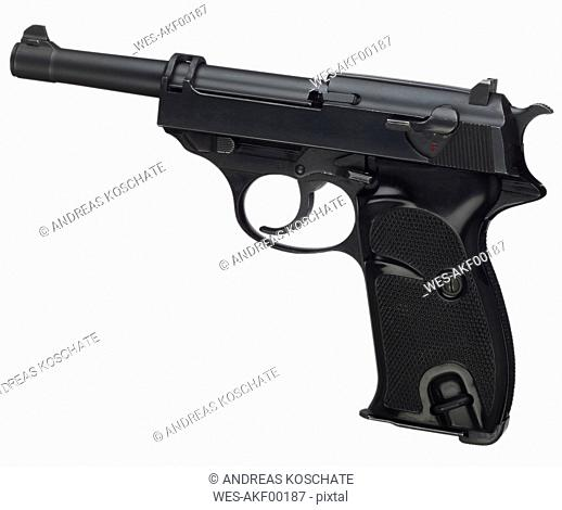 Pistol against white background, close up