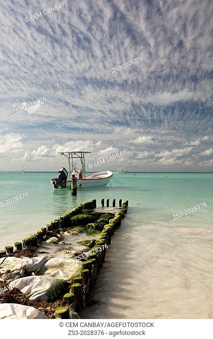 A damaged pier and a boat on Isla Mujeres Island, Cancun, Quintana Roo, Yucatan Peninsula, Mexico