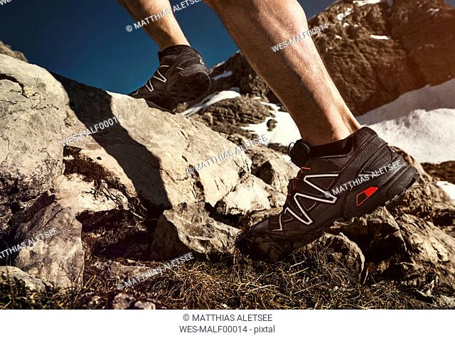 Close-up of man running in mountains
