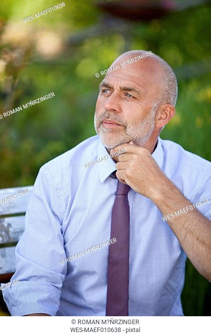 Portrait of pensive businessman having a rest