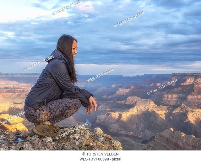 USA, Arizona, Grand Canyon National Park, tourist enjoying the view