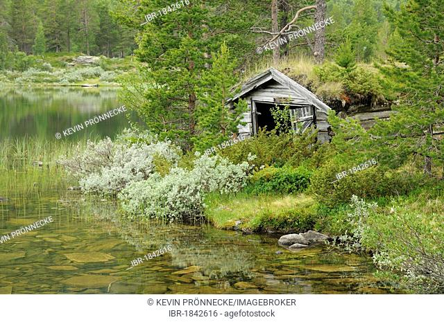 Old cabin by a lake, Lom, Norway, Scandinavia, Europe