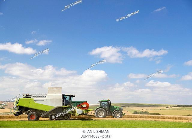 Combine Harvester Harvesting Wheat Crop In Field