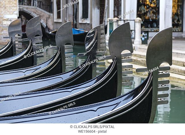 """Europe, Italy, Veneto, Venice. Gondolas lined with typical prow called """"""""ferro"""""""""""