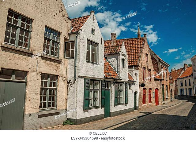 Brick facade of houses in typical style of the Flanders's region in street of Bruges. With many canals and old buildings