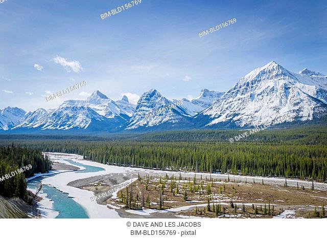 Snowy river, forest and mountains, Banff, Alberta, Canada