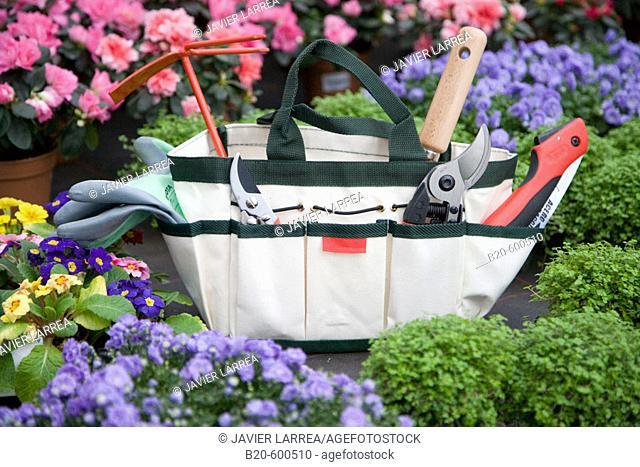 Bag with pruning and gardening tools. Garden, Tree nursery. Gipuzkoa, Euskadi. Spain