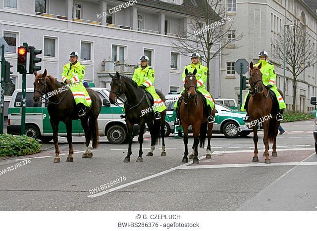 police riding squat on a street, Germany, North Rhine-Westphalia, Ruhr Area, Essen