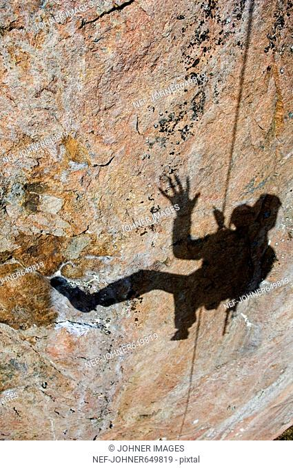 A climber on a wall of rock, Sweden