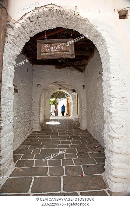 Man walking through an archway in town center Chora, Ios, Cyclades Islands, Greek Islands, Greece, Europe