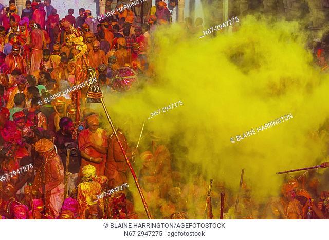 Large crowds celebrating Lathmar Holi in the village of Nandgaon, near Mathura, during Holi (festival of colors), Uttar Pradesh, India