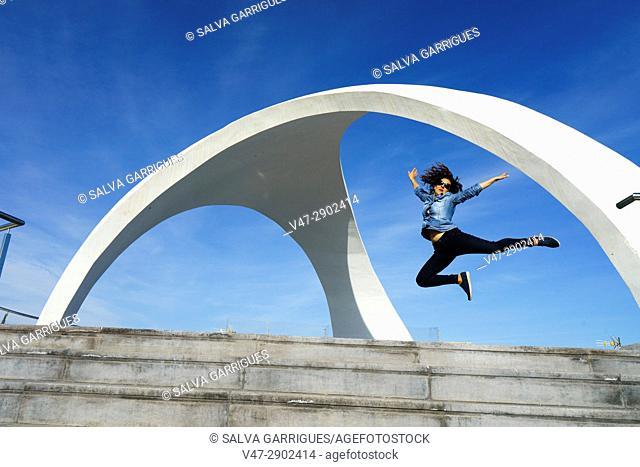 Woman jumping in Viewpoint of La Calica de Aguilas, Murcia, Spain
