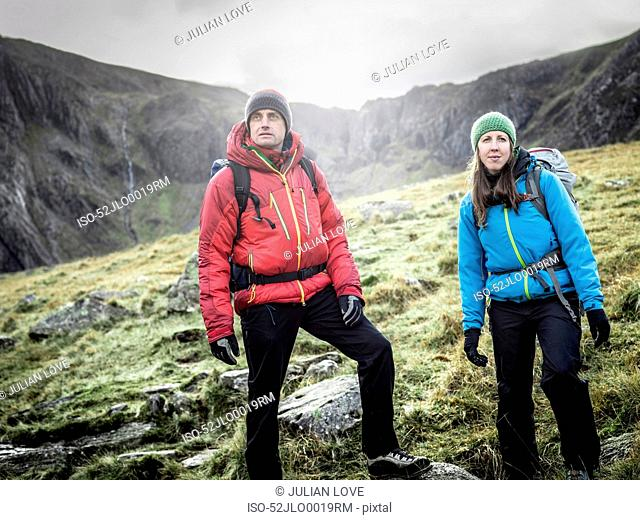 Couple hiking in rocky landscape