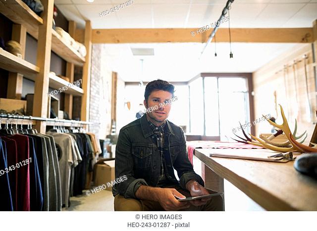 Portrait confident business owner with digital tablet shop