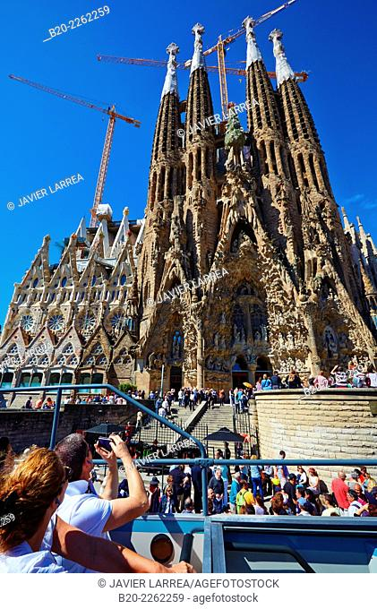 Tourist Bus passing by the Basilica of the Sagrada Familia by Antonio Gaudí, Barcelona, Catalonia, Spain