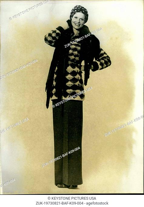 Aug. 21, 1973 - Lanvin presents this pant ensemble with a mink tie under the brown and yellow knit jacket's collar for his fall and winter collection for...
