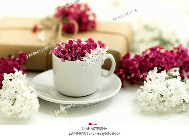 White Cup with lilac on white background