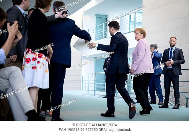 18 June 2019, Berlin: Federal Chancellor Angela Merkel (CDU) and Volodymyr Selensky, President of Ukraine, leave the room at the Federal Chancellery after a...