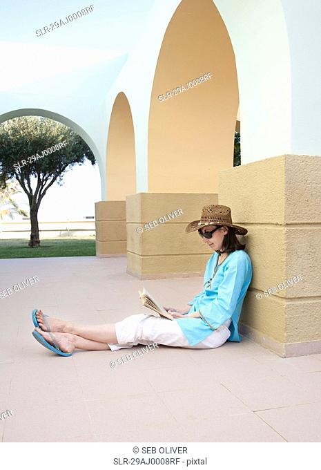 Woman sitting and reading