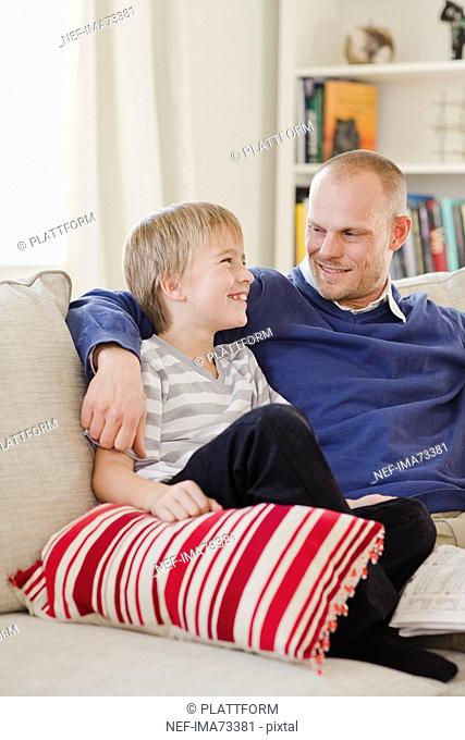Father and son in a couch, Sweden