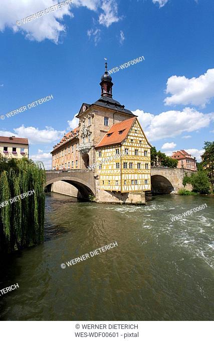 Germany, Bavaria, Franconia, Bamberg, Old City Hall over river at night