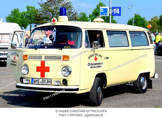 A VW T2 with the logo of the German Red Cross on it at the Maikaefertreffen (May Beetle Meeting) in Hanover (Germany), 01 May 2019