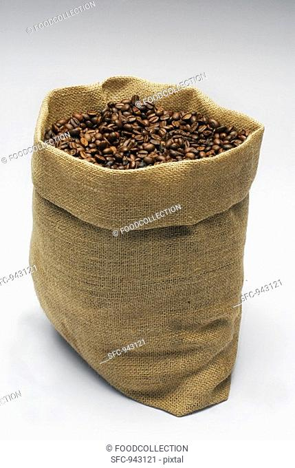 A jute sack full of roasted coffee beans