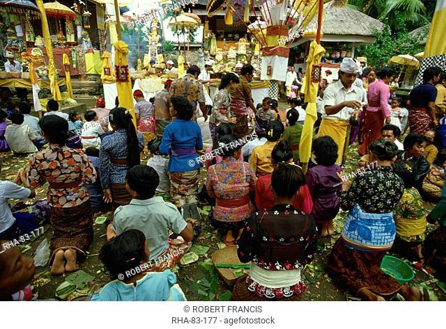 Hindu worshippers receiving holy water in Pura Taman Pule temple on Kuningan Day, Mas, Gianyar District, Bali, Indonesia, Southeast Asia, Asia