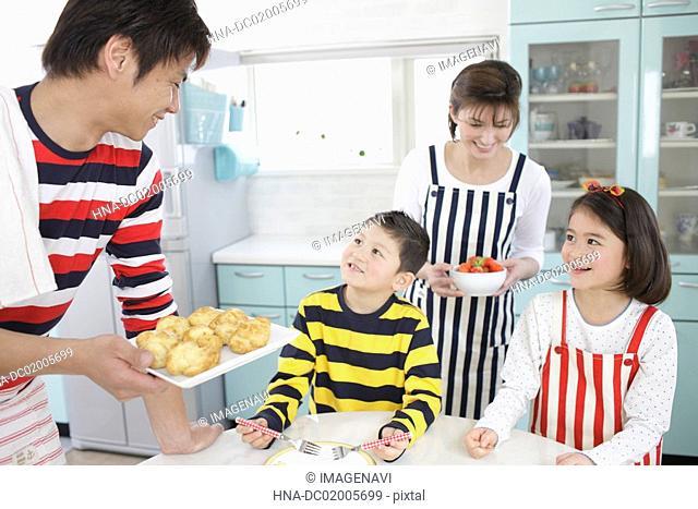 Family preparing sweets