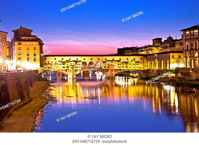 Ponte Vecchio bridge and Arno river waterfront in Florence evening view, Tuscany region of Italy