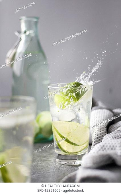 Water with lime and ice cubes