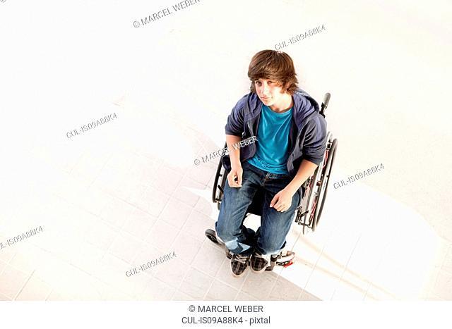 Teenage boy in wheelchair, high angle