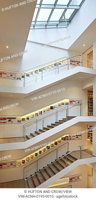 Overall elevated view of stairwell with wall-inserted book display. Foyles, London, United Kingdom. Architect: Lifschutz, 2014