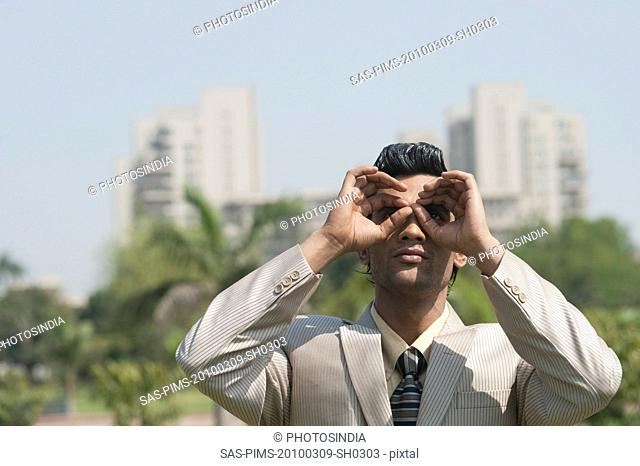 Businessman pretending to wear glasses