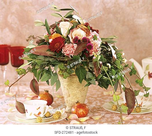 Autumnal arrangement with pomegranates