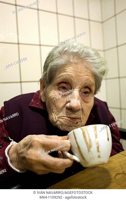 Old woman drinking chocolate