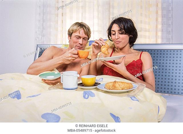 Young couple at the breakfast in the bed