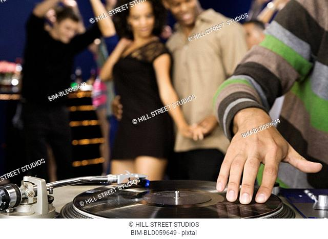 African male dj scratching record