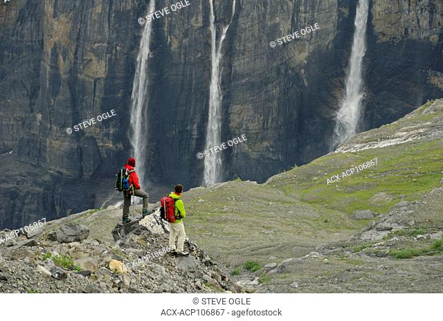 Hiking in front of the Lyell Icefield and waterfalls near Icefall Lodge north of Golden, BC in the Canadian Rockies