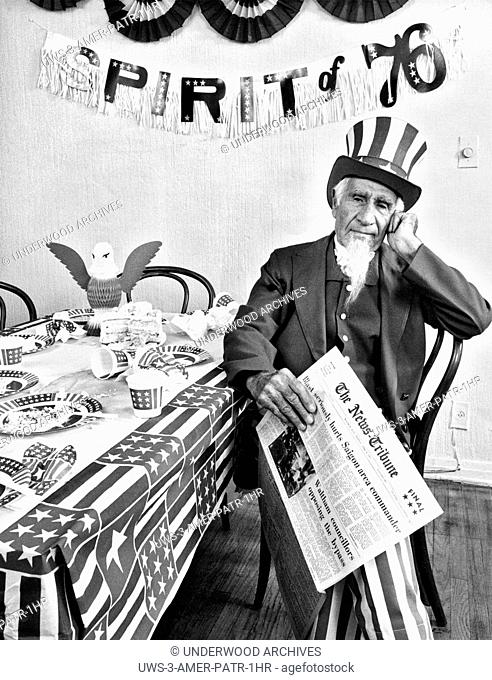 Waltham, Massachusetts: April 8, 1975.It's a sad day for Uncle Sam holding a newspaper with the latest headlines from the Vietnam War