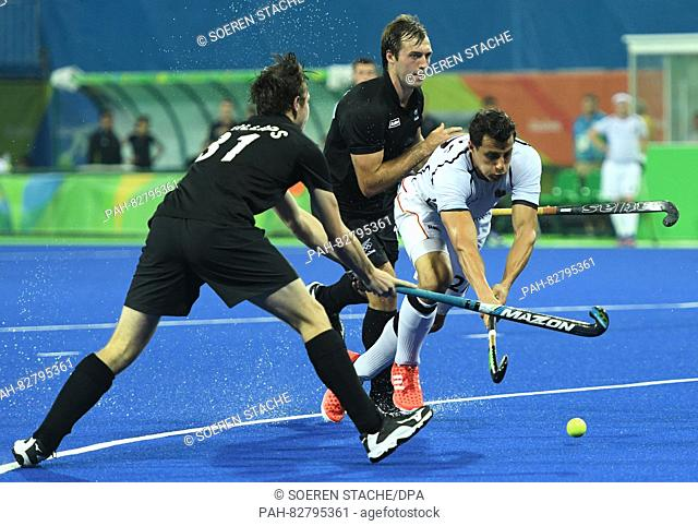 Timur Oruz (R) of Germany and of Hayden Phillips (L) New Zealand in action during Men's Field Hockey Quarterfinal match between Germany and New Zealand at the...