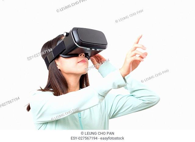 Woman using VR device and finger pointing up